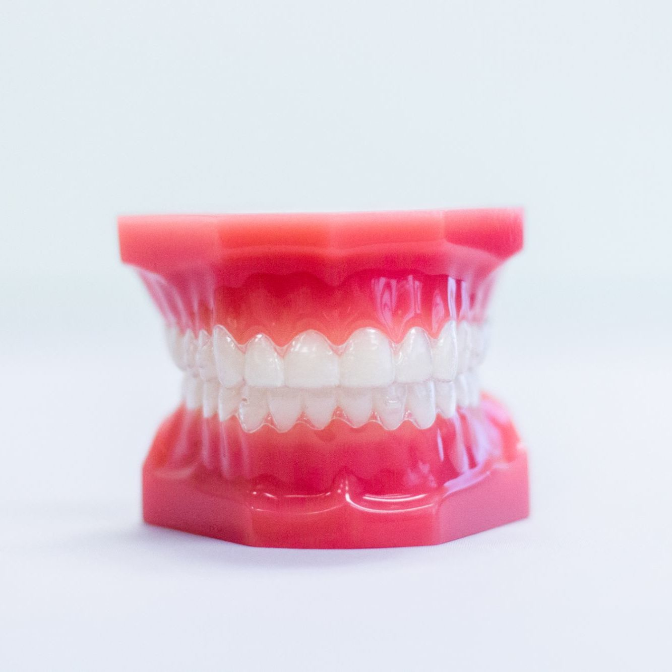 Invisalign aligners on a teeth mold